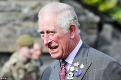 The Prince put on a dapper display for his day on the farm, sporting a grey checked suit and wine-coloured tie