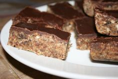 Homemade protein bars using almonds, coconut, and (dates).  Have tried these, and they're my go-to breakfast now!  Mmmm.
