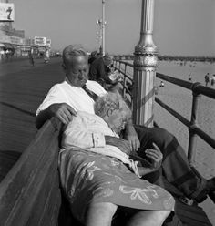 HAROLD FEINSTEIN Asleep on Board Walk, Coney Island , 1946
