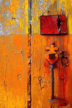 Orange, old wood not treated painted rough with original door knobs, vintage Knobs And Knockers, Door Knobs, Door Handles, Les Doors, Peeling Paint, Happy Colors, Warm Colors, Vibrant Colors, Mellow Yellow