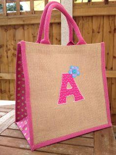 Applique detailed jute bag