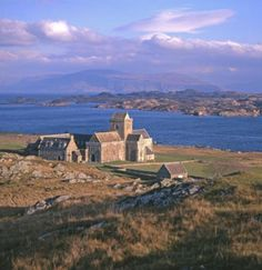 Iona Abbey, Scotland: go north 'cross the border to Oban, take the Caledonian-MacBrayne car ferry to Mull (w/side trip to see the yachts/village at Tobermorey via single track roads), then park at Fionnphort & take the 5 min ferry across to Iona.  Nice B if you don't want to stay at the Abbey, fab white sand beaches, turquoise sea, a seat of Xnty, spirituality... lovely
