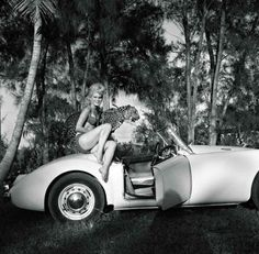 Bunny Yeager - Elaina Lekas with her pet Leopard Nero, Seated on MG, 1965.