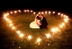 This wedding picture idea with sparklers is absolutely adorable!  :-)