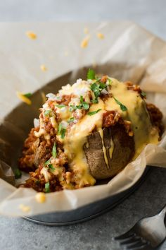 The ultimate vegetarian comfort food, this chili baked potato is smothered in a hearty bulgur chili and easy homemade cheese sauce.