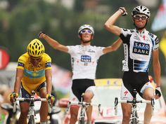 Frank Schleck of Luxembourg and Saxo Bank crosses the finish line in front of Alberto Contador and Andy Schleck to win stage 17 of the 2009 Tour de France from Bourg-Saint-Maurice to Le Grand Bornand on July 22, 2009 in Le Grand Bornand, France.