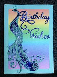 Peacock Very Large layered card front on Craftsuprint designed by Tina Fallon - made by Erma Thompson - For the background and inside of the card I printed a rainbow color on cardstock. The card was cut with my Silhouette Cameo, the first layer I used a aqua color cardstock. The second lay of the Peacock and the Birthday Wishes I used the cup561477_1056 Sparkle and Print design in Navy Blue, then cut the design. The top layer for the Peacock I used a good textured cardstock and cut with my…