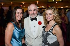 007 and two lovely guests at a James Bond themed event.