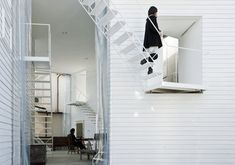 """Yokohama Apartment by Osamu Nishida + Erika Nakagawa / On Design: """"This timber framed apartment accommodates four artists. The small bedrooms are lifted five meters (16.4 feet) above the ground on the triangular corners of the building. The open-air covered courtyard is shared by the residents as their communal studio and gallery. The exterior stairs to bedrooms are sometimes used as seating when there are performances in the gallery."""" text from www.japlusu.com"""