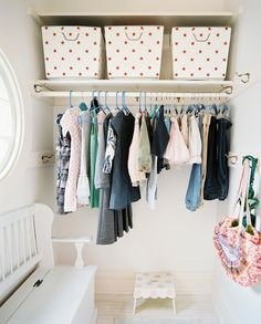 Organization - A polka-dotted stool and a white bench in a girl's closet.