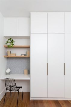 Tiny, simple office nook in white with open blonde wood shelves and felt tack bo. Tiny, simple office nook in white with open blonde wood shelves and felt tack bo… – Wardrobe Design Bedroom, Bedroom Cupboard Designs, Bedroom Cupboards, Bedroom Desk, Closet Bedroom, Bedroom Storage, Home Bedroom, Teen Bedroom, Wall Of Closets