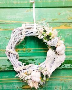 Frontdoorwreath with artificial plants, angelwings& heartshape decor