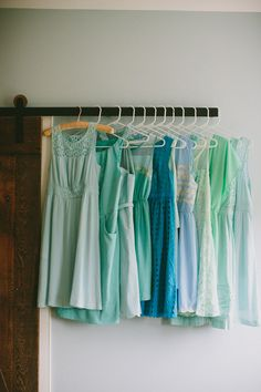 bridesmaids dresses in blues and greens // photo by Amber Vickery // view more: http://ruffledblog.com/garden-wedding-at-terrain