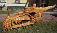 9 Foot Dragon Sculpture. Chainsaw carving out of a giant cottonwood tree. By TheBearGuy.com
