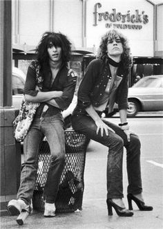 Johnny Thunders and David Johansen, 1973 - photo by Bob Gruen. 1970's rock n roll singer. It takes a brave man to dress up as a woman.