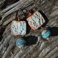LOVE the Porcelain Squares (*polymer) and Lampwork in gorgeous soft turquoise blue
