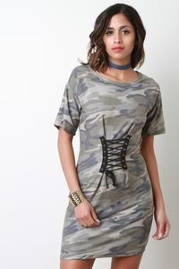 This t-shirt dress features a french terry fabrication with camouflage print, round neckline, short sleeves, self-tie corset cinched waist, and a mini-length he French Terry, Shirt Dress, T Shirt, Camouflage, Corset, Short Sleeves, Dresses For Work, Clothes For Women, Collection