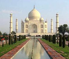 Taj Mahal. It took 22 years to build this magnificent building. Once covered in precious stones, it is now bare in some areas because of thieves. The marble is translucent. On a sunny day there is no need for light because it literally glows inside.