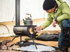 This portable woodburning stove that can heat a whole tent pioneer-style:   19 Surprisingly Portable Items You Didn't Know You Needed