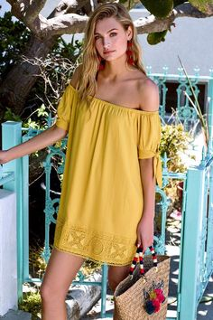 Lulus Exclusive! Catch some rays in the Moment In The Sun Mustard Yellow Lace Off-the-Shoulder Dress! Woven poly falls from an elasticized off-the-shoulder neckline, into short sleeves with tying cuffs. Shift silhouette is finished with crocheted lace trim.