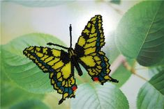 how to make beaded butterfly. detailed photo tutorial. shows how to attach wings to body.