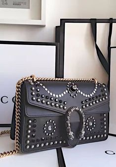 Gucci Dionysus Studded Medium Shoulder Bag is made in black leather and is enhanced by black crystal and metal studs. Find more Gucci handbags at http://www.luxtime.su/gucci-bags