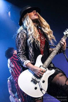 Orianthi (Alice Cooper Band) and solo. Chick can shred when she wants to. #guitarist http://www.pinterest.com/TheHitman14/musician-guitarists-%2B/