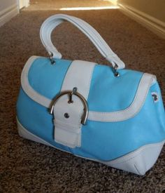 COACH leather blue satchel tote. I really love this bag, and it says it was made in the USA, but I think it may be my only fake! What do you think? Either way, I will carry it, because it is just so cute! :).