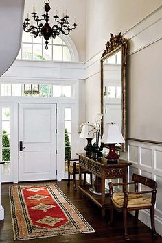 Pretty foyer, but I would have to paint it a color!