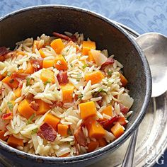 Combat the fall chill with this warm, cozy orzo bowl. Cooking the butternut squash in a Dutch oven makes this recipe much faster than roasting.