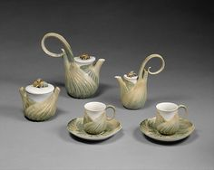 This coffee service (1988.287.1–.7) embodies the Art Nouveau style in ceramics. The designer chose the fennel plant to literally encase the functional wares, thereby integrating their utilitarian aspects with Art Nouveau's embrace of naturalistic forms