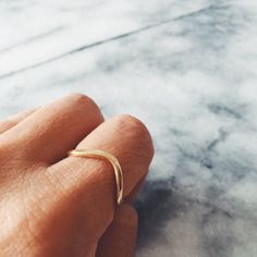 Our Gold Wave Ring is gorgeously delicate - and perfect for stacking. We designed this ethereal gold wave ring with summer days and warm nights in mind - it's the perfect piece to take to the great ou