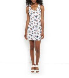 Mini-robe blanche côtelée avec imprimé petites fleurs