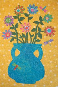 Spring Fling Fusible Applique | FaveQuilts.com would look nice in my sewing room.