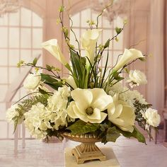Litigation Office Cream Magnolia and Hydrangeas with Calla Lillies Elegantly styled silk flower centerpeice arranged with soft cream hydrangeas, magnolias, and calla lillies. Accented with wispy branches, ranunculus and fern. Magnolia Centerpiece, Silk Flower Centerpieces, Artificial Floral Arrangements, Church Flower Arrangements, Church Flowers, Vase Arrangements, Beautiful Flower Arrangements, Beautiful Flowers, Wedding Centerpieces