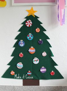 Felt Christmas Tree Perfect for toddlers - just their height and they can rearrange to their hearts content. Designer: bought a ton of little color square felt to make ornaments. The snowman one is surprisingly her favorite. These are 3 inch circles. Thx: Make it Cozee