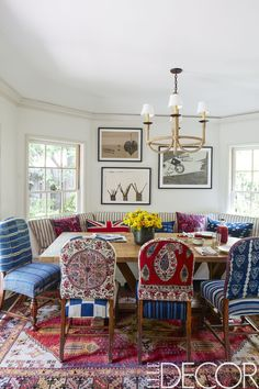The chairs in the dining area came from Driver's former house and were re-covered in vintage Islamic and African textiles, the banquette is covered in a Pindler stripe, the chandelier is by Hollywood at Home, the vintage rug is from Jamal's Rug Collection and the watercolors are by Konstantin Kakanias.