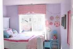 love the colors! purple walls. light pink, bright pink, light blue, and white accents.