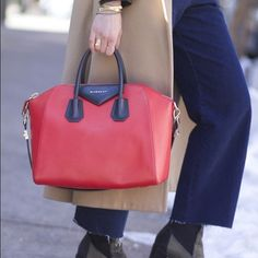 """Givenchy medium Antigona bag in rare colors AUTHENTIC Givenchy bag has been the """"it"""" bag for a while now. So chic but I rarely wear it (that's me in the first pic though). Rare in red/black. In very good condition with no noticeable marks/damage. Matte calfskin with contrast calfskin accents and shiny golden hardware.Tote handles, 4"""" drop; flat, crossbody strap; 11 1/2"""" drop.Envelope flap with Givenchy metal logo. Inside, one zip pocket and two open pockets; Long leather tabs protect base of…"""