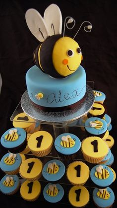 Bumble Bee Cake and Cupcakes - use different colors and decorations