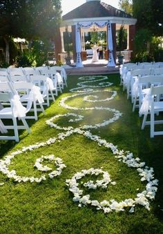 Outdoor wedding decoration but with flower petals to match the rest of the decorations