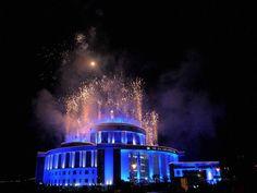 Fireworks go off at the Mahanagar Palika Building on New Year's eve, in Navi Mumbai.