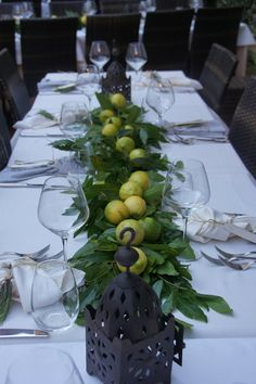Citrus and Greenery tablescape.  so simple and beautiful. It could be apples, pumpkins, vegetables...easily adapted to the current season.  Add Candles at ends.
