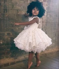 Flower girl is dancing in her beautiful lace flower girl dress