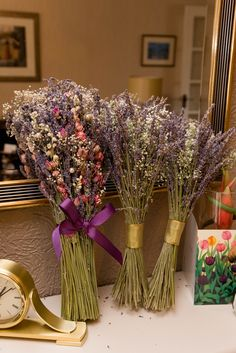 Wedding flowers - dried flowers and ribbon. The large one i bought on the net and changed myself (added ribbon, cut the stems a bit and added more lavender) The two bridesmaids ones I made myself