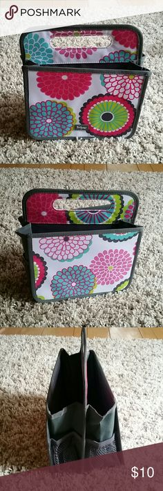 New Thirty One floral Double Duty caddy New Thirty One floral carry caddy. No longer in plastic but never used. Bought for my daughters nursery but the colors didn't match.  Take a look at my many other tall, maternity, nursing, boys and baby girl clothes listed! I'm always open to bundled offers! Most prices are firm unless bundled. Thirty One Bags