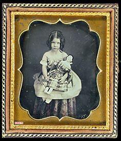 Daguerreotype girl with doll   circa 1840's.
