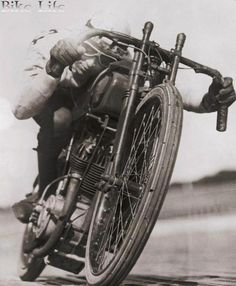 1923 Ralph Hepburn encircling the track at limit of speed on his motorcycle