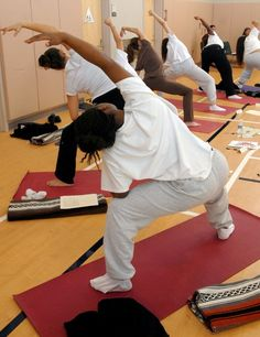 File photo: Teenage girls practice yoga at the Margaret J. Kemp Camp for girls in San Mateo, Calif., on Monday, February 9, 2009. The Art of Yoga Program is part of the juvenile justice system that supports the physical, mental, emotional and spiritual development of teenage girls in the facility. (Dan Honda/Staff)