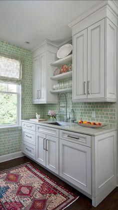 Cocina con azulejos verdes